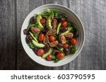 large bowl of salad on wood  | Shutterstock . vector #603790595