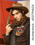 handsome man in cowboy clothes | Shutterstock . vector #603794624