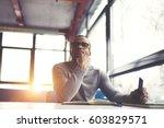 pensive afro american handsome...   Shutterstock . vector #603829571