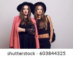 two attractive young models  in ... | Shutterstock . vector #603844325