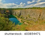 Small photo of Panorama of Velka Amerika (Big America, Czech Grand Canyon) is a partly flooded, abandoned limestone quarry near Morina village, in the Central Bohemian Region of the Czech Republic