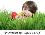 young cute boy found an easter...   Shutterstock . vector #603865715