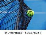 tennis ball hitting on the net | Shutterstock . vector #603875357
