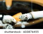 Burning Cigarette Close Up....