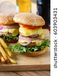 double cheese burger and french ... | Shutterstock . vector #603903431