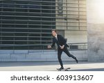 businessman in a suit on a... | Shutterstock . vector #603913607