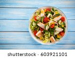 greek salad with grilled... | Shutterstock . vector #603921101