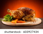 roast chicken on cutting board  | Shutterstock . vector #603927434