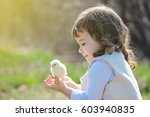 girl with a chick on his arm.... | Shutterstock . vector #603940835