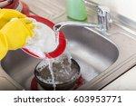 cleaning dishware kitchen sink... | Shutterstock . vector #603953771