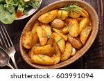 roasted potato in brown bowl... | Shutterstock . vector #603991094
