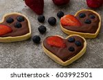heart shape chocolate tart with strawberry and blueberry