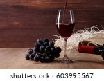 red wine pouring. wineglass...   Shutterstock . vector #603995567
