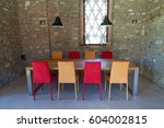 table with colored chairs in a... | Shutterstock . vector #604002815