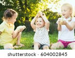 children playing with chickens | Shutterstock . vector #604002845