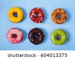 donuts with icing. sweet glazed ... | Shutterstock . vector #604013375