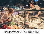 at the supermarket. handsome... | Shutterstock . vector #604017461
