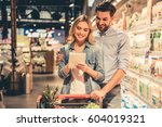 beautiful couple is reading... | Shutterstock . vector #604019321
