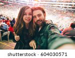 happy young couple in love... | Shutterstock . vector #604030571