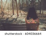 sad woman sitting on the bench... | Shutterstock . vector #604036664