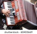 Musician Playing On Accordion...