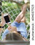 lazy time. woman in a hammock... | Shutterstock . vector #604037525
