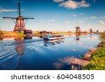 famous windmills in kinderdijk... | Shutterstock . vector #604048505