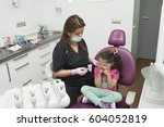 dentists with a patient during... | Shutterstock . vector #604052819