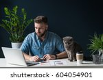 young bearded businessman sits... | Shutterstock . vector #604054901