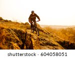 enduro cyclist riding the... | Shutterstock . vector #604058051