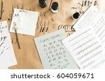calligraphy sheets  nibs  paper ... | Shutterstock . vector #604059671