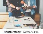 teamwork. young business woman... | Shutterstock . vector #604073141
