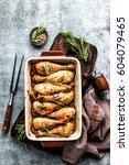 baked chicken drumsticks on a... | Shutterstock . vector #604079465