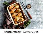 baked chicken drumsticks on a... | Shutterstock . vector #604079645