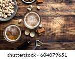 two glasses of fresh beer and... | Shutterstock . vector #604079651