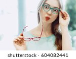 young woman with funny face... | Shutterstock . vector #604082441