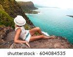 shot of a beautiful young woman ... | Shutterstock . vector #604084535