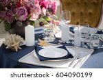 table setting at a luxury... | Shutterstock . vector #604090199