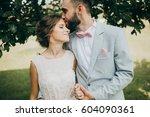 gentle bride and groom posing... | Shutterstock . vector #604090361