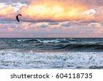 kitesurfer rides kite through... | Shutterstock . vector #604118735