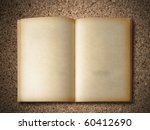 Old Book on particle board background - stock photo