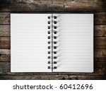 Open White Note Book on Wood Horizontal - stock photo