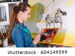 girl in painting studio | Shutterstock . vector #604149599