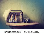 old radio with hat camera and... | Shutterstock . vector #604160387