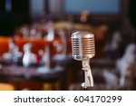 retro karaoke microphone on... | Shutterstock . vector #604170299