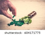 medicine herb. herbal pills in... | Shutterstock . vector #604171775