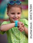 cute little girl is using...   Shutterstock . vector #604176584