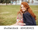 Portrait Of A Smiling Red Head...
