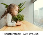 little girl with a growing... | Shutterstock . vector #604196255