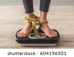 cropped image of woman feet... | Shutterstock . vector #604196501
